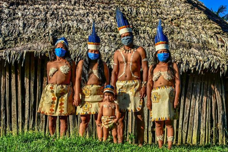 A family of Colombian Huitoto wearing chirurgical masks