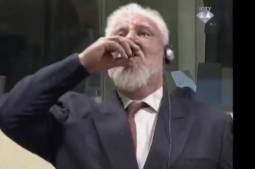 Chaos at UN court as Bosnian Croat defendant 'takes poison' and dies